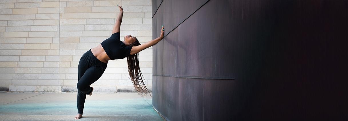 Undergraduate dance student Talia Howard dancing on campus