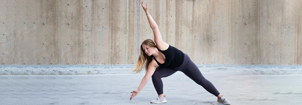 Undergraduate dancer Katelynn Malmstedt dancing on campus